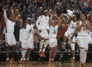 Jordan Hosey, center, is excited as the Longhorns close out a win. Photo courtesy of Texas Athletics.