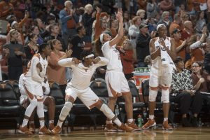 Jordan Hosey, center, celebrates a bucket late in a game. Photo courtesy of Texas Athletics.