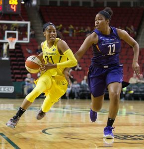 Jordin Canada blazes by her defender. Neil Enns/Storm Photos.