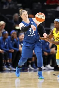 Lindsay Whalen dishes a pass against the Chicago Sky. Photo by Jordan Johnson/NBAE via Getty Images.