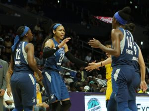 Maya Moore rallies teammates after a bucket. Maria Noble/WomensHoopsWorld.