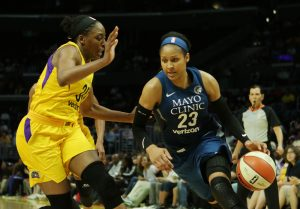 Maya Moore initiates the drive past Sparks forward Nneka Ogwumike. Maria Noble/WomensHoopsWorld.