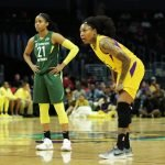 Jordin Canada and Cappie Pondexter watch a free throw. Maria Noble/WomensHoopsWorld.