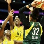 Alysha Clark looks to pass over the defense. Maria Noble/WomensHoopsWorld.