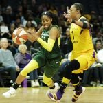 Jordin Canada drives on Odyssey Sims. Maria Noble/WomensHoopsWorld.