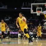 Candace Parker drives up court on a fast break. Photo by Maria Noble/WomensHoopsWorld.