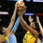 Cheyenne Parker is guarded by Jantel Lavender. Photo by Maria Noble/WomensHoopsWorld.