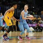 Courtney Vandersloot is guarded by Alana Beard. Photo by Maria Noble/WomensHoopsWorld.