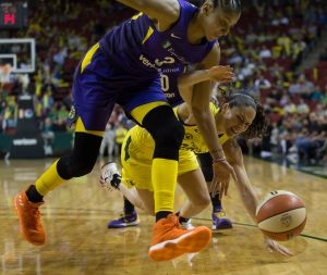 Candace Parker and Sue Bird battle for the ball. No foul was called on the play and the Storm got possession. Neil Enns/Storm Photos.