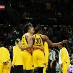 Candace Parker and Nneka Ogwumike confer during a pause in the game. Maria Noble/WomensHoopsWorld.