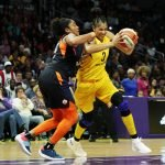 Candace Parker drives against Morgan Tuck. Maria Noble/WomensHoopsWorld.