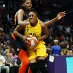 Nneka Ogwumike drives to the basket against Jonquel Jones. Maria Noble/WomensHoopsWorld.