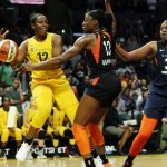 Chelsea Gray tries to retain ball control against Chiney Ogwumike. Maria Noble/WomensHoopsWorld.