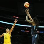 Jessica Breland shoots over Candace Parker. Maria Noble/WomensHoopsWorld.