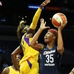 Angel McCoughtry takes a tough shot against Essence Carson. Maria Noble/WomensHoopsWorld.