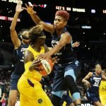 Angel McCoughtry defends Essence Carson. Maria Noble/WomensHoopsWorld.