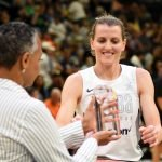 WNBA president Lisa Borders hands Allie Quigley the three-point shooting contest trophy. Maggi Stivers/WomensHoopsWorld.
