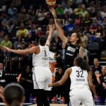 Brittney Griner shoots over Liz Cambage. Maggi Stivers/WomensHoopsWorld.