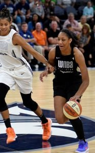 A'ja Wilson drives to the hoop as Candace Parker follows. Maggi Stivers/WomensHoopsWorld.