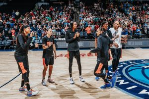 Seimone Augustus, Sue Bird, DeWanna Bonner, Diana Taurasi, Sylvia Fowles and Brittney Griner wait to shoot. Photo courtesy of Phoenix Mercury.