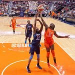 Uncasville, Connecticut/USA - July 17, 2018: Connecticut Sun forward Chiney Ogwumike (13) shoots as Atlanta Dream forward Jessica Breland (51) defends during a WNBA basketball game between the Atlanta Dream and the Connecticut Sun at Mohegan Sun Arena. The Atlanta Dream defeated the Connecticut Sun 86-83. Chris Poss Photo.