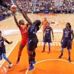 Uncasville, Connecticut/USA - July 17, 2018: Connecticut Sun forward Chiney Ogwumike (13) shoots over Atlanta Dream center Elizabeth Williams (1) during a WNBA basketball game between the Atlanta Dream and the Connecticut Sun at Mohegan Sun Arena. The Atlanta Dream defeated the Connecticut Sun 86-83. Chris Poss Photo.