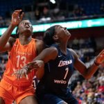 Uncasville, Connecticut/USA - July 17, 2018: Connecticut Sun forward Chiney Ogwumike (13) and Atlanta Dream center Elizabeth Williams (1) battle for a rebound during a WNBA basketball game between the Atlanta Dream and the Connecticut Sun at Mohegan Sun Arena. The Atlanta Dream defeated the Connecticut Sun 86-83. Chris Poss Photo.