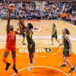 UNCASVILLE, CONNECTICUT/USA - July 20, 2018: Connecticut Sun forward Chiney Ogwumike (13) shoots during a Seattle Storm vs Connecticut Sun WNBA basketball game at Mohegan Sun Arena. Chris Poss Photo.
