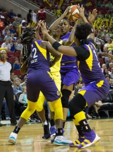 The Sparks defense smothers Jewell Loyd. Neil Enns/Storm Photos.