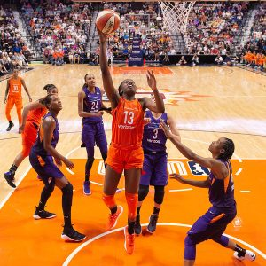 Chiney Ogwumike lays it up and in. Chris Poss Photos.