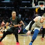 Lindsay Whalen reacts to being bumped by Odyssey Sims. Maria Noble/WomensHoopsWorld.