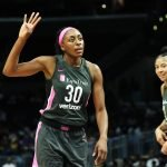 Nneka Ogwumike gives a hand signal to a teammate. Maria Noble/WomensHoopsWorld.