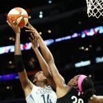 Nneka Ogwumike tries to deflect Temi Fagbenle's shot. Maria Noble/WomensHoopsWorld.
