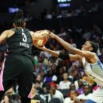 Candace Parker gets a hand on Temi Fagbenle's pass. Maria Noble/WomensHoopsWorld.
