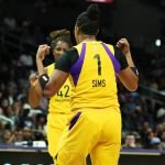 Odyssey Sims flexes after scoring. Maria Noble/WomensHoopsWorld.