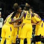 The Sparks huddle up on court. Maria Noble/WomensHoopsWorld.