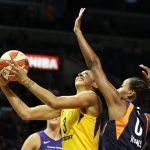Candace Parker shoots under pressure. Maria Noble/WomensHoopsWorld.