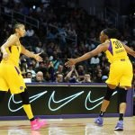 Candace Parker and Nneka Ogwumike slap hands. Maria Noble/WomensHoopsWorld.