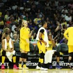 Players on the bench react to game action. Maria Noble/WomensHoopsWorld.