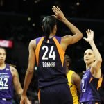 DeWanna Bonner and Diana Taurasi high-five after a bucket. Maria Noble/WomensHoopsWorld.