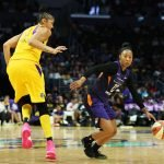 Briann January slides past Candace Parker. Maria Noble/WomensHoopsWorld.