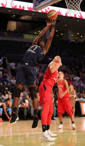 Elizabeth Williams snatches a rebound over Elena Delle Donne. Brian Savage photo.