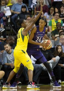 DeWanna Bonner looks to pass around Jewell Loyd. Bonner scored a team-high 27 points for the Mercury. Neil Enns/Storm Photos.
