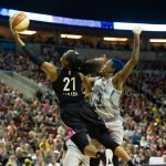 Jordin Canada glides up for a basket against Danielle Robinson. Lindsey Wasson/Seattle Storm.