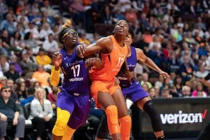 Essence Carson, left, and Chiney Ogwumike battle for positioning at a game earlier this season. The Sparks and Sun are fighting for playoff position tomorrow. Chris Poss photo.
