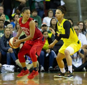Kristi Toliver looks to beat Alysha Clark's defense. Neil Enns/Storm Photos.