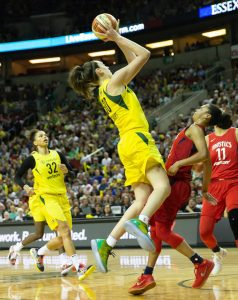 Breanna Stewart elevates over Kristi Toliver to score. Neil Enns/Storm Photos.