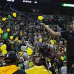 Breanna Stewart holds up a broom to indicate the Storm's sweet in the Finals. Neil Enns/Storm Photos.