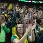 Several thousand fans cheer during the ceremony. Neil Enns/Storm Photos.