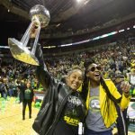 Kaleena Mosqueda-Lewis and Crystal Langhorne hoist the trophy. Neil Enns/Storm Photos.